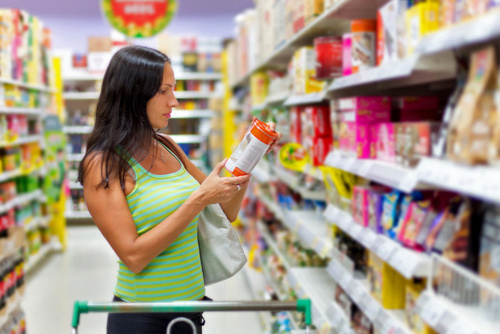 Woman checking food labels